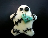 Voodoo Doll Magnet has pins in his heart and glows in the dark