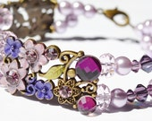 Flower Bracelet Purple Flowers Pearls and Crystals