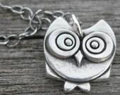 Skillet, sterling silver owl pendant