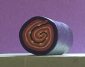 Brown and Yellow Dotted Spiral raw polymer clay cane