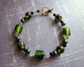 "Green glass bracelet  ""On Reserve"""