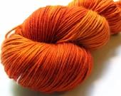 Flame - hand dyed superwash merino sock yarn