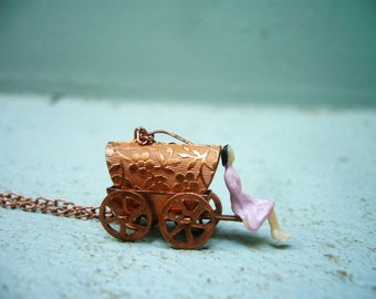 Carry me bronze carriage and a lady necklace