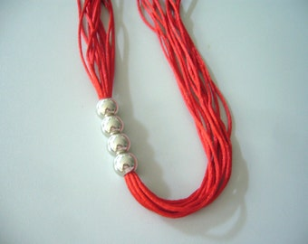 Red necklace with silver beads