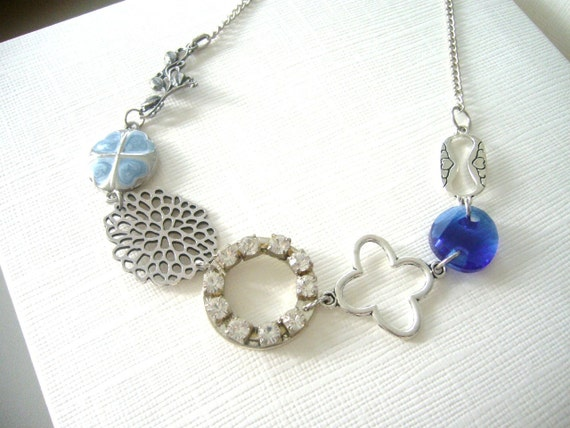 Chunky silver, blue necklace with rhinestones
