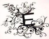 Papercuts-cutouts-handcuts-- E