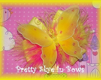 An Extravagant and Eye-Catching Yellow Butterfly Boutique Hair Bow Clip