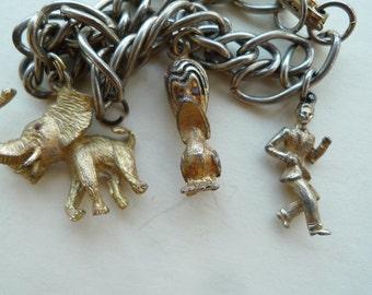 vintage charm bracelet  lucky elephant, duck ,dancing man