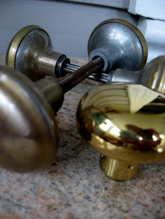 4 Doorknobs - 2 pairs of working antique brass and steel knobs & 1 new brassy style