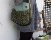 a large tough ruffles shoulder bag in aqua with olive
