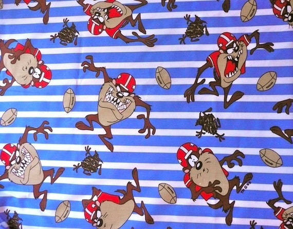Tasmanian Devil Playing Football On Blue And White Striped