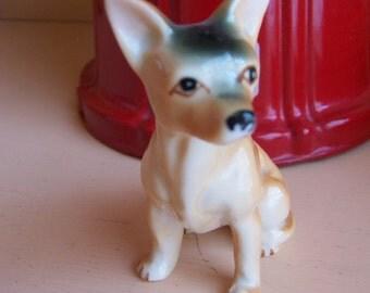 cute little porcelain canine figurine