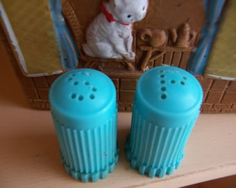 tiny teal plastic shakers