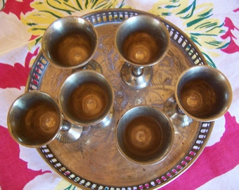 silver tray with six tiny goblets