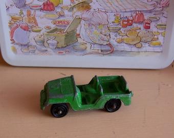 tiny green metal jeep