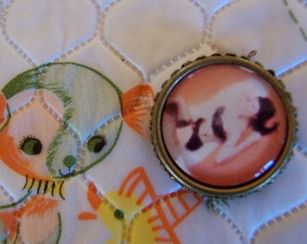 very old pin up girl pendant