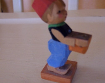 swiss made wooden boy figurine