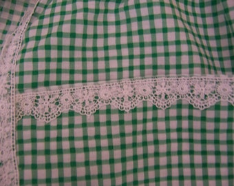 green checkered apron with white lace