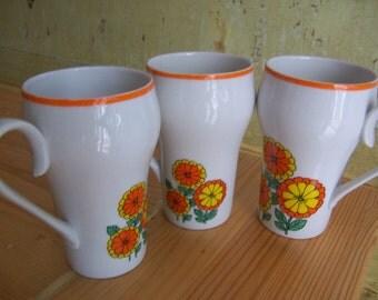 exquisite orange and yellow flowered mugs