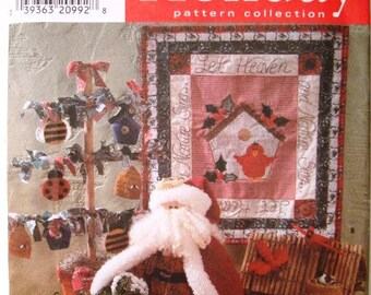 Simplicity 7897 Holiday Pattern Collection. Let Heaven And Nature Sing... Wall Hanging, Santa, Folk Tree Christmas Decorations. Uncut.