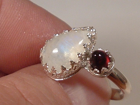 Sterling Silver Natural Rainbow Moonstone with a Bullet Garnet Ring