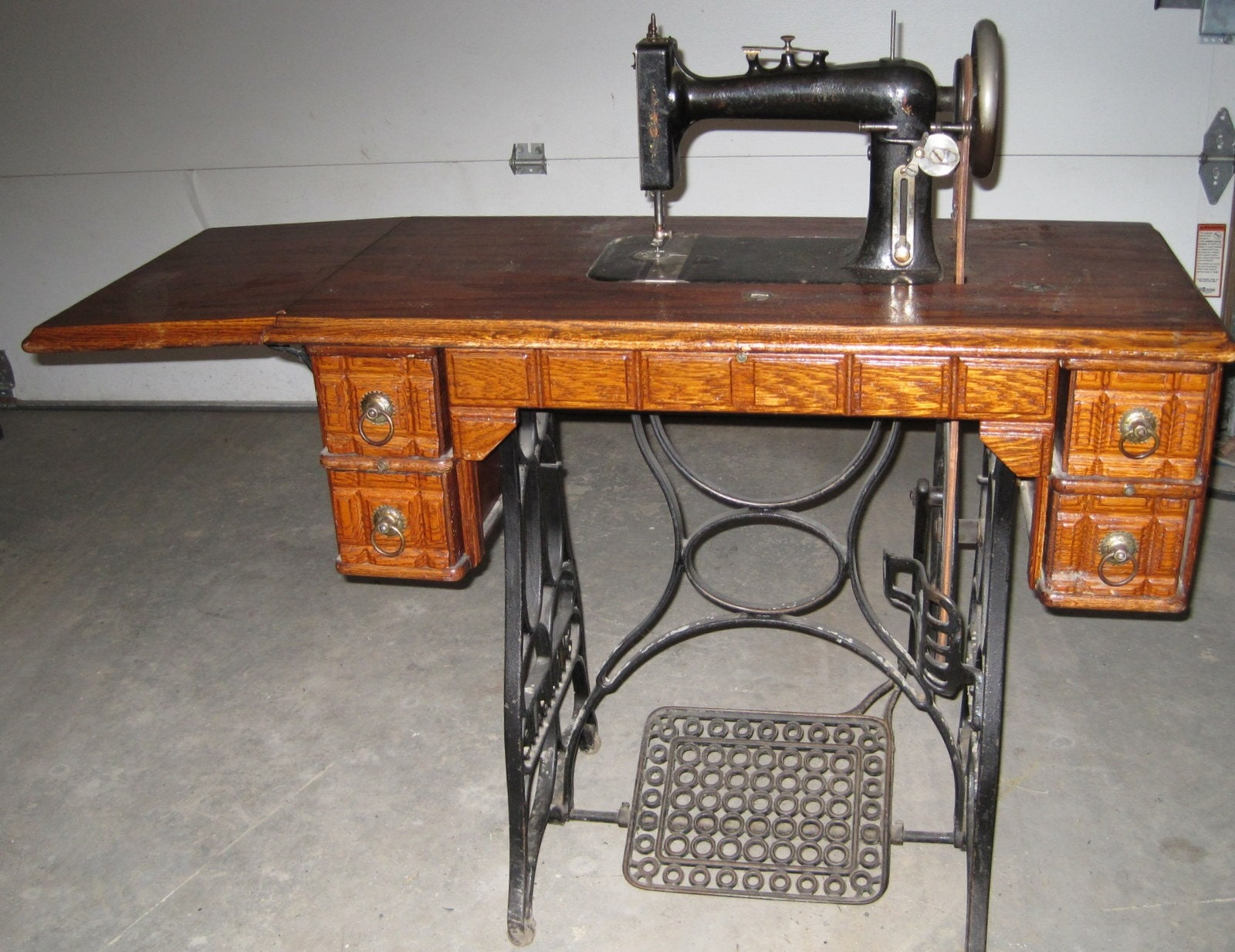 antique oak treadle sewing machine cabinet cast iron base 2