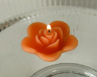 12 Tropical Coral floating rose wedding candles for table centerpiece and reception decor.
