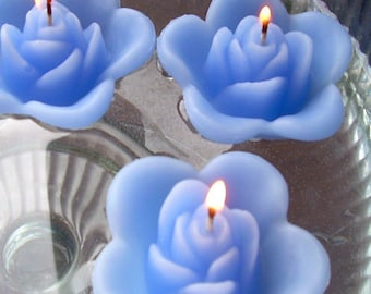 12 Periwinkle floating rose wedding candles for table centerpiece and reception decor.