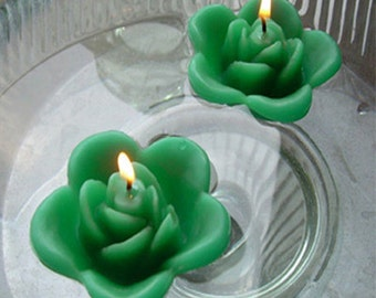 12 Kelly green floating rose wedding candles for table centerpiece and reception decor.