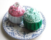 Pair of yummy, calorie-free, knitted cupcakes