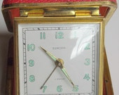 Vintage wind-up travel clock with red leather effect case