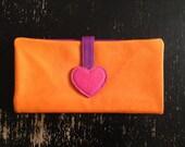 Color block orange leather purse by Maya Shalev.