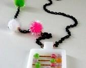 Fuzzy Logic . vintage abacus cotton candy pom pom necklace