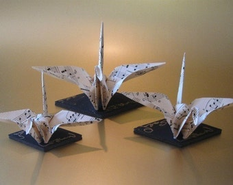 Musical Crane Family, A Set of Three Little Cranes Crafted With Sheet Music