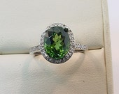 AAA GREEN TOURMALINE 3.44 Carats 10 X 8mm. in a 14k White gold ring with diamonds (.32ct) Ring 0357
