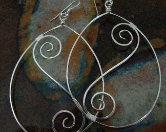 Curlycues... Sterling silver earrings wire wrapped oval hoops