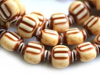 vintage lucite natural ivory and brown pressed beads 15mm, 8.5 inch strand