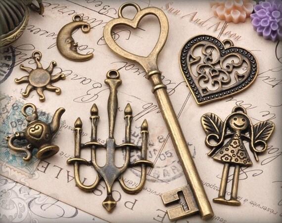 7 Vintage Style Charms and Pendant Set - Fairy, Skeleton Key, Tea Pot. Chandelier, Sun And Moon (SM001c)