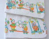 RESERVED.......VTG NOS cotton receiving blankets with circus motif