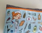 pale blue zipper medicine bag with a nurse illustration