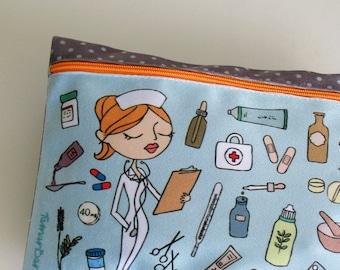pale blue zipper medicine clutch with an illustration of a nurse