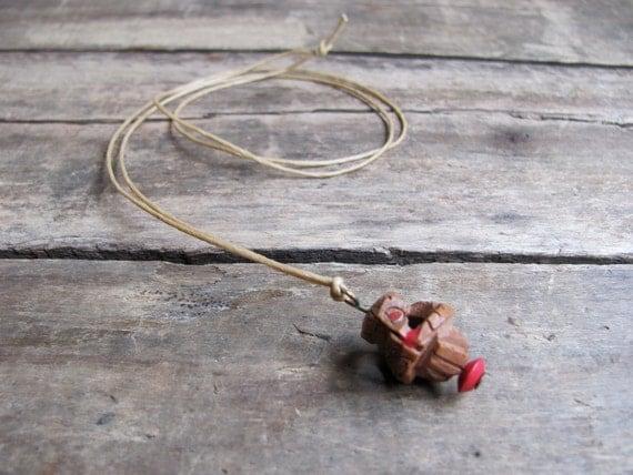 vintage 1930s peach pit monkey charm necklace