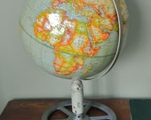 Vintage globe on industrial stand