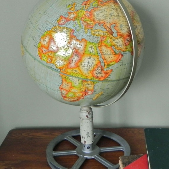 Vintage globe on industrial stand