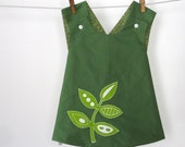 Reversible dress with leaf applique