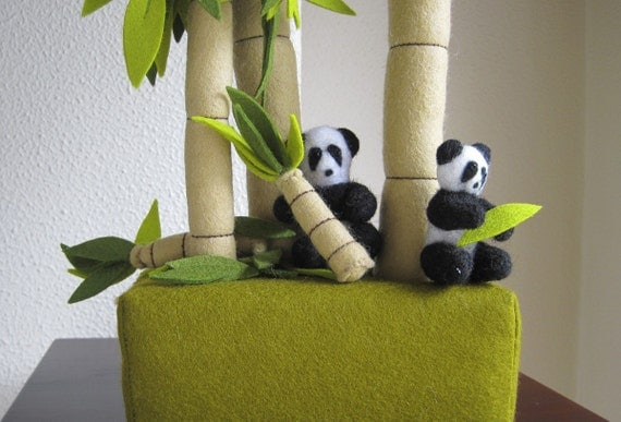 Clump of bamboo trees with two pandas