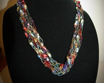 Adjustable classic rainbow ladder trellis ribbon necklace