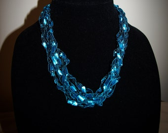 Teal ladder trellis ribbon necklace