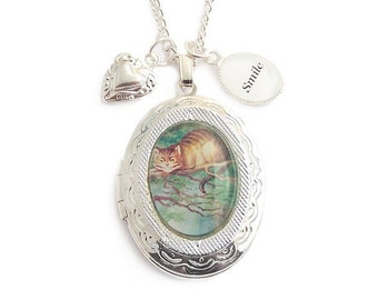 Alice in Wonderland locket necklace Cheshire cat smile We're all mad here