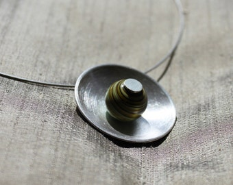 Silver pendant with glass bead